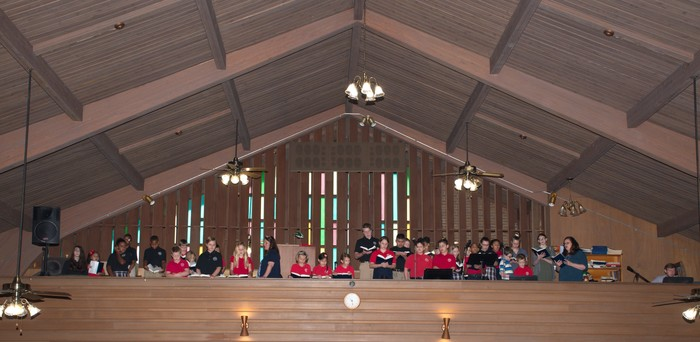 A picture of St. Mary's choir loft with all of the children singing