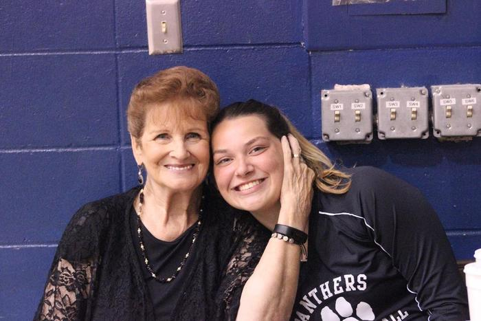 Mrs. Troutman and Christina Arendale cheering on our volleyball girls