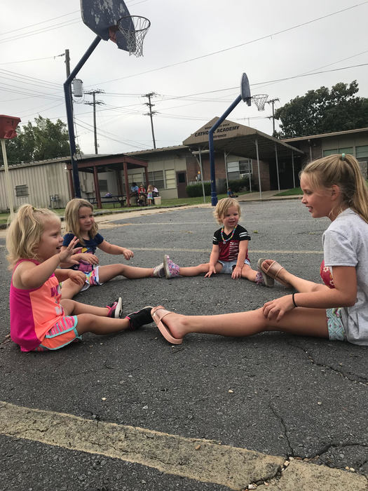 Kamryn teaching Pre-K 3 girls how to play ball
