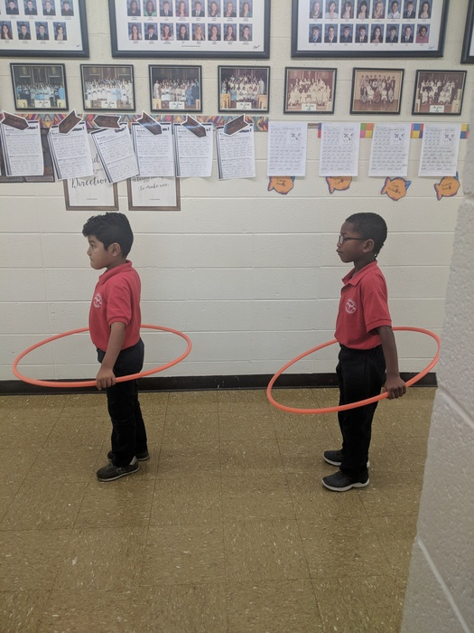 two of our first graders learning how to keep distance in line